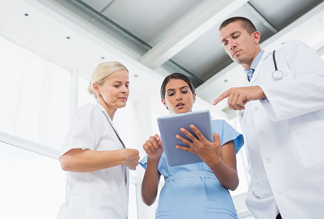 Group of doctors looking at AI solutions for healthcare